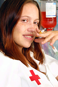 Smoking teen nurse Essence with red hair and freckles in hospital