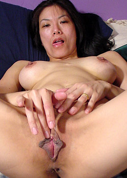 Asian girl Azalia of Popp-O-Mat with huge labia and big tits